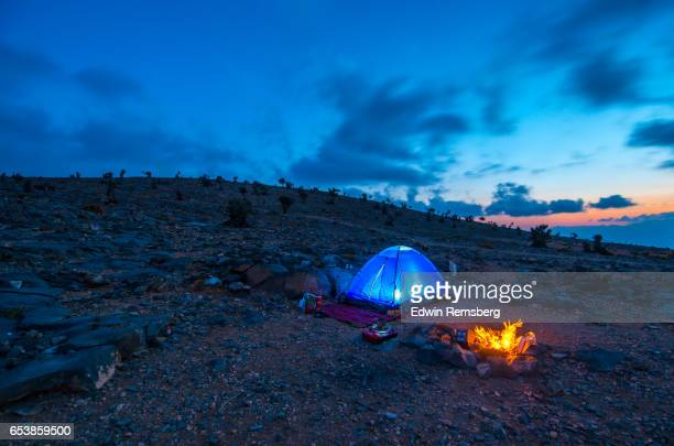 Tent and campfire in the mountains