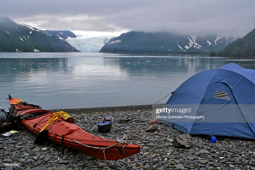 Tent and kayak on beach in Alaska