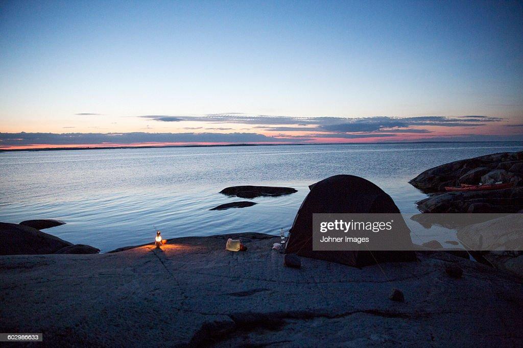 Tent at dusk by lake