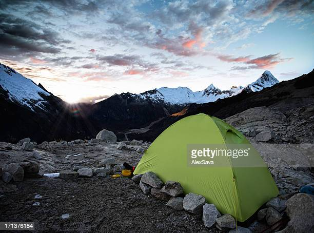 tent at sunrise high in the mountains