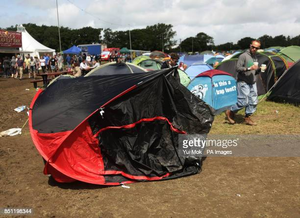 A tent blown over by the strong winds at the Isle of Wight Festival in Seaclose Park Newport Isle of Wight PRESS ASSOCIATION Photo Picture date...