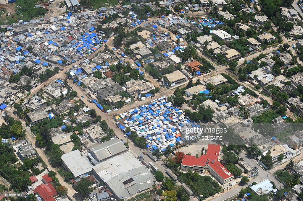 A tent city in Leogane, 33 Km south of Port-au-Prince, is seen on June 2, 2010. Haiti faces an 'immense challenge' in rebuilding after January's earthquake, President Rene Preval told a donors' conference June 2 called to speed payment of billions of dollars in pledges. AFP PHOTO / Thony BELIZAIRE
