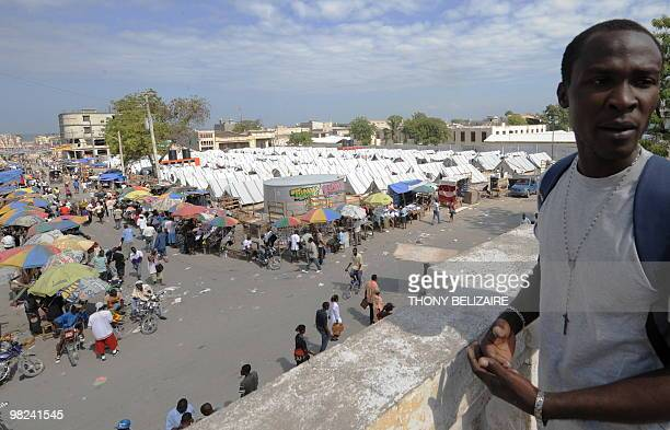 A tent city is bustling with people on Easter April 4 2010 in PortauPrince Haiti AFP PHOTO Thony BELIZAIRE