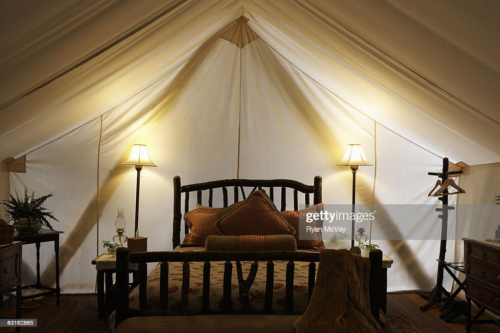 Tent interior with bed and lamps. : Stock-Foto