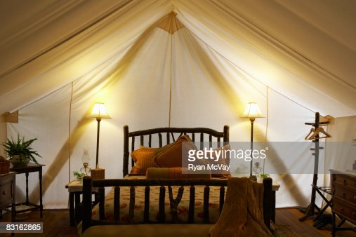 Tent interior with bed and lamps. : Stockfoto