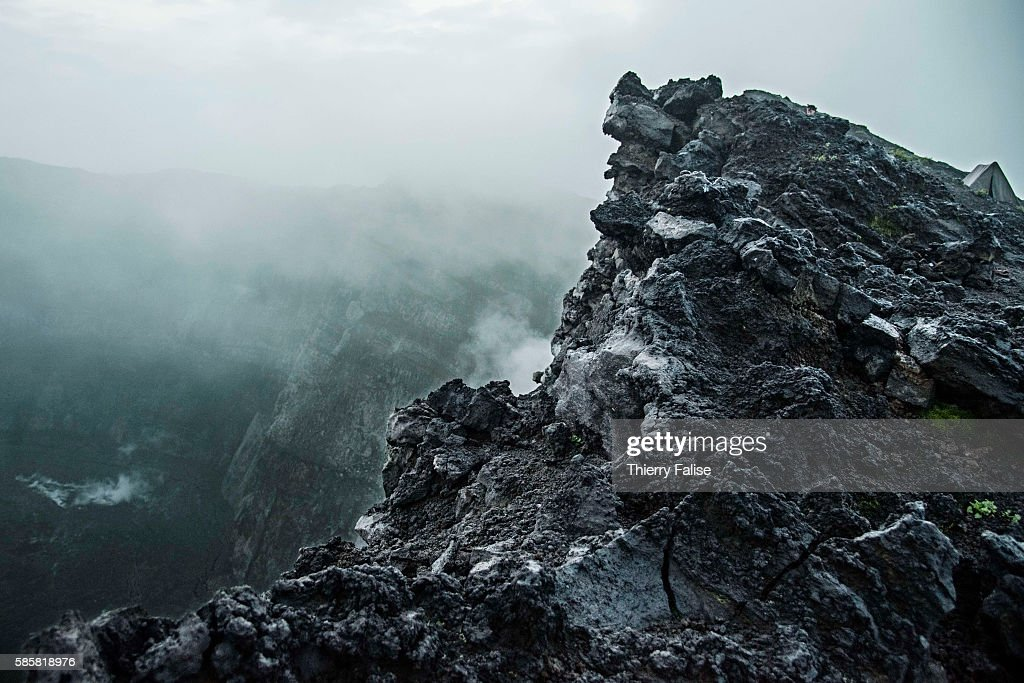 A tent is put up on the edge of the main crater of Mount Nyiragongo The Nyiragongo is an active stratovolcano with an elevation of 3470 metres in the...