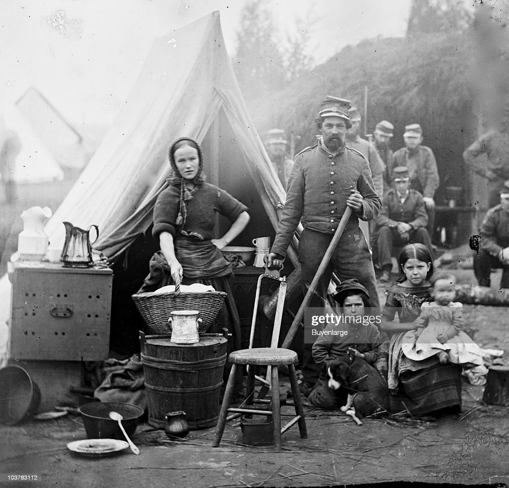 Tent life of the 31st Penn Inf at Queen's farm vicinity of Fort Slocum Washington DC 1861 The husband and wife stand with children and a baby The...