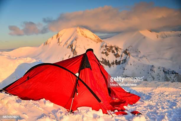 Tent on snowy mountain ridge