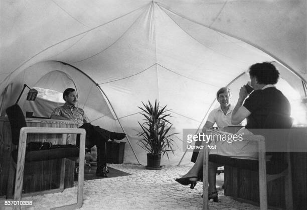 A tent serves as office for Danny Flemings left and GR Nordstrom as they chat with Denver Post reporter Eva Hodges Watt Credit Denver Post