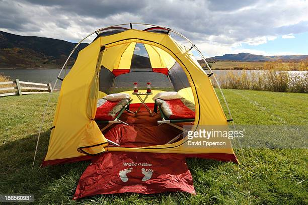Tent set up at lakeside campsite in fall season