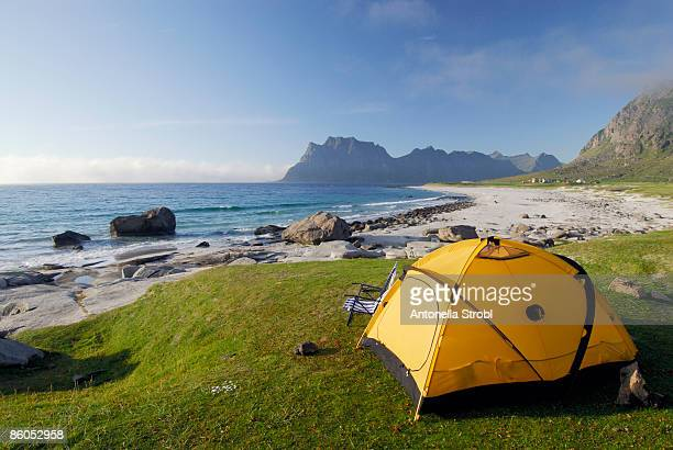 Tent set up by ocean shore