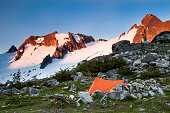 A tent sits near the Cascade Glacier on the Ptarmigan Traverse, North Cascades, Washington