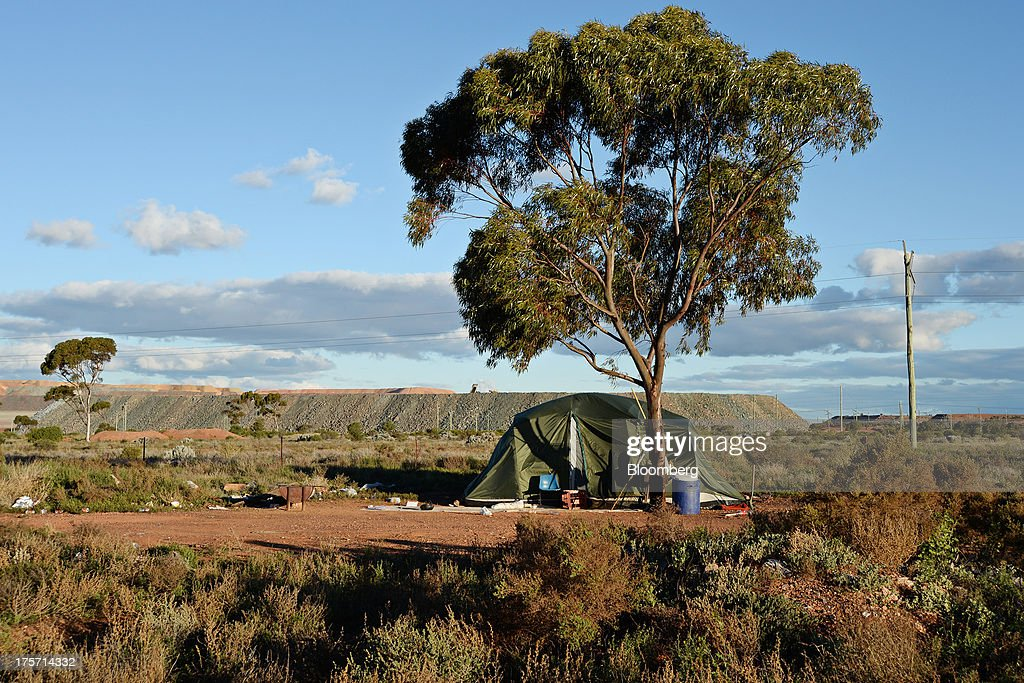 A tent stands in front of The Super Pit on the outskirts of Kalgoorlie, Australia, on Tuesday, Aug. 6, 2013. Kalgoorlie, a town in the Goldfields-Esperance region of Western Australia, is home to the annual Diggers & Dealers mining forum. Photographer: Carla Gottgens/Bloomberg via Getty Images