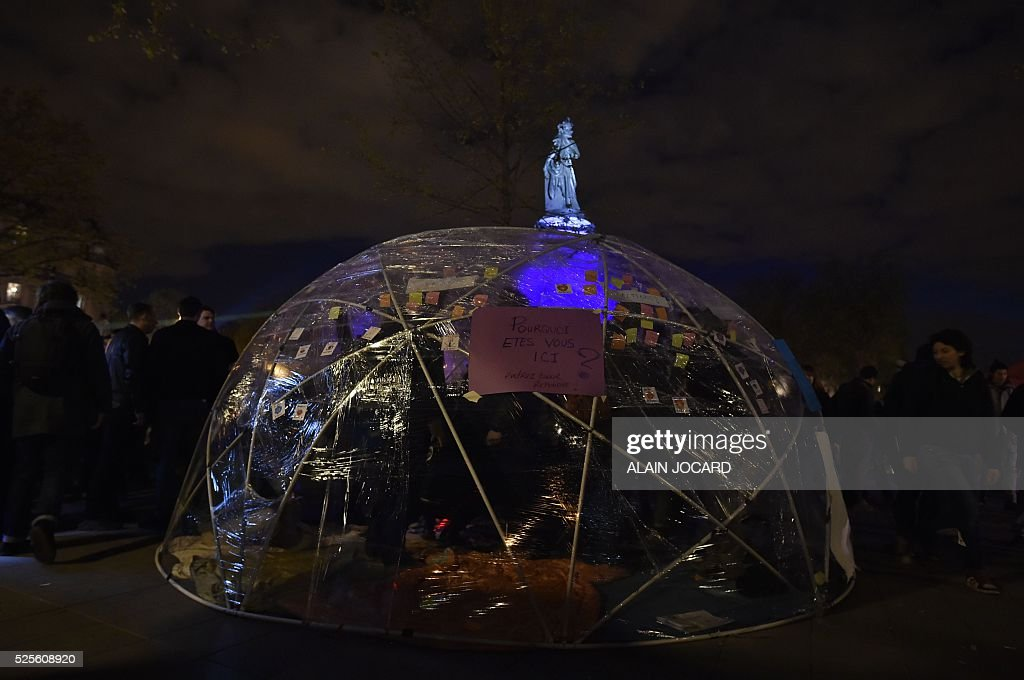 A tent with a note reading 'Why are you here ? Enter to give your answer' during the Nuit Debout, or 'Up All Night' movement on April 28, 2016 on Place de la Republique in Paris. The 'Nuit Debout' demonstrations began on March 31 in opposition to the government's proposed labour reforms.