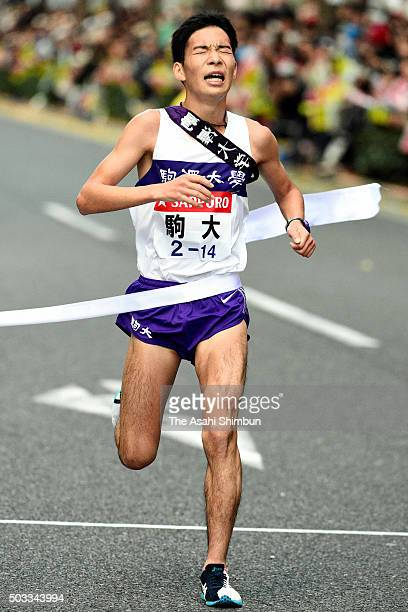 Tenth and final runner of Komazawa University Yoshiki Nakamura crosses the finishing tape as third during the 92nd Hakone Ekiden on January 3 2016 in...
