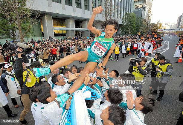 Tenth runner Toshinori Watanabe of Aoyama Gakuin University is thrown into the air after winning the 92nd Hakone Ekiden on January 3 2016 in Tokyo...