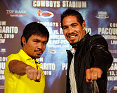 Ten–time world champion Congressman Manny 'PacMan' Pacquiao left poses with Antonio 'The Tijuana Tornado' Margarito who will fight for the World...