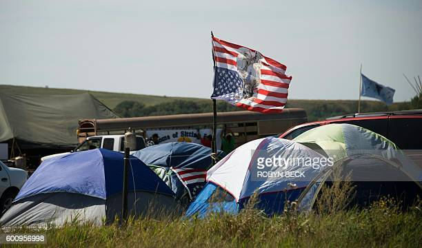 Tents and a flag are seen at an oil pipeline protest encampment near Cannon Ball North Dakota where members of the Standing Rock Sioux tribe and...