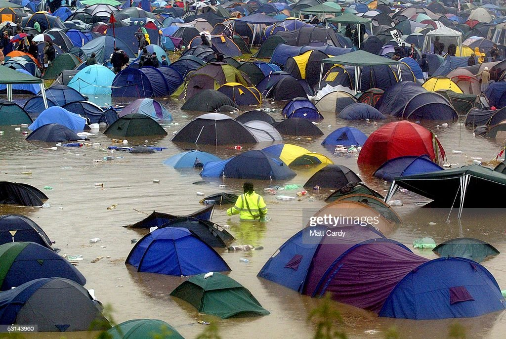 Tents and festival-goers are surrounded by flood water on the first day of the Glastonbury Music Festival 2005 at Worthy Farm, Pilton on June 24, 2005 in Glastonbury, England. The festival runs until June 26.