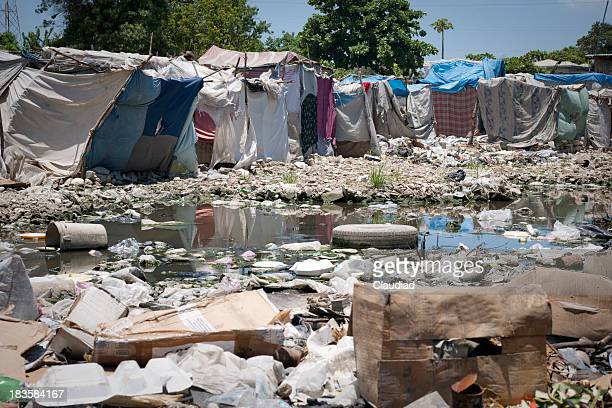 Tents and garbage in a refugee camp