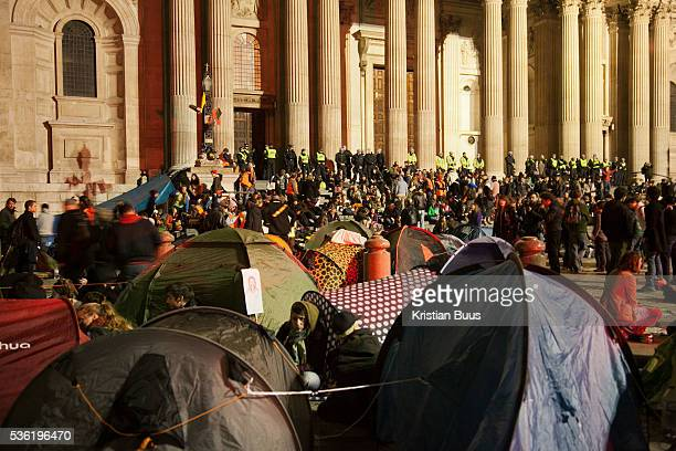 Tents and people in the square and on the steps The London Stock Exchange was attempted occypied in solidarity with Occupy Wall in Street in New York...