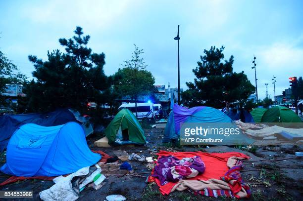 Tents are pictured as French antiriot police force CRS officers prepare the evacuation of a makeshift camp at Porte de la Chapelle in the north of...