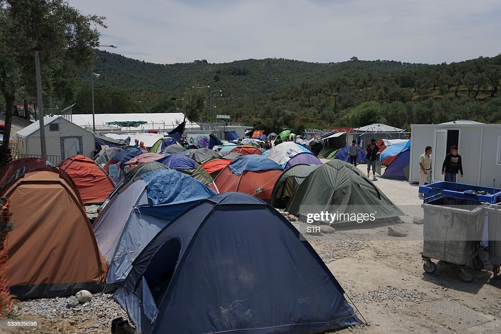 Tents are seen at the Moria detention camp for migrants and refugees at the island of Lesbos on May 24, 2016. So far this year, the International Organisation for Migration says an estimated 190,000 migrants and refugees have entered Europe by sea, arriving in Italy, Greece, Cyprus and Spain. Another 1,359 have died en route. / AFP / STR