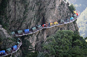 Tents are set up on a 1000meterhigh plank road at Laojun Mountain on July 16 2016 in Luoyang Henan Province of China Visitors arrived at Laojun...