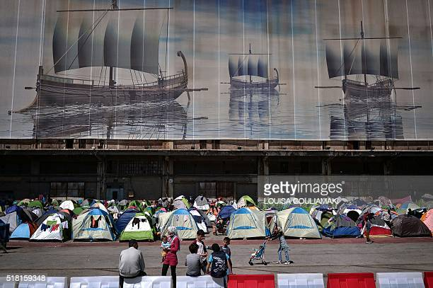 TOPSHOT Tents are staged at the port of Piraeus where more than 5500 migrants and refugees found temporary shelter on March 30 2016 Some 53000...