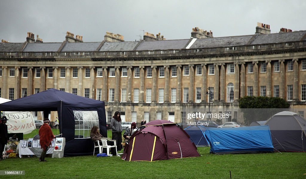 Tents belonging to campaigners from the Occupy Bath protest group are pitched in front of Bath's Grade 1 Royal Crescent on November 17, 2012 in Bath, England. The small group of local representatives of the Occupy movement - which staged an occupation in the city for six weeks last year - moved into Royal Victoria Park in front of the historic landmark on Friday night, but claimed they would end the protest on Sunday.