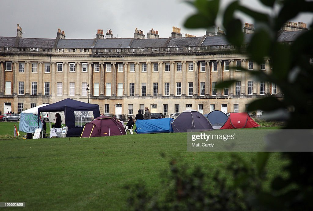 Tents belonging to campaigners from the Occupy Bath protest group are seen pitched in front of Bath's Grade 1 Royal Crescent on November 17, 2012 in Bath, England. The small group of local representatives of the Occupy movement - which staged an occupation in the city for six weeks last year - moved into Royal Victoria Park in front of the historic landmark on Friday night, but claimed they would end the protest on Sunday.
