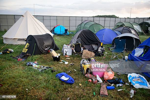 Tents equipment and debris litter the camping fields on the morning after the Glastonbury Festival of Music and Performing Arts on Worthy Farm in...