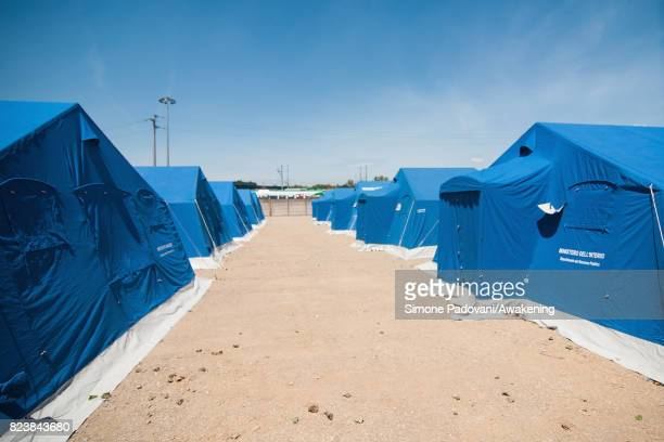 Tents house asylum seekers until the new wing has been built to enlarge the capacity of the Hub CARA center on July 27 2017 in Bologna Italy In an...
