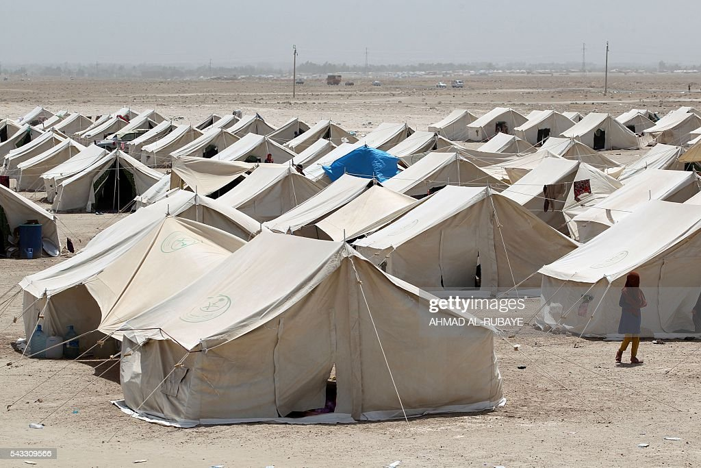 Tents sheltering Iraqis displaced from the city of Fallujah are seen at a newly opened camp in Amriyat al-Fallujah on June 27, 2016, south of Fallujah. Iraqi forces on June 26 wrapped up operations in Fallujah and declared the area free of jihadists from the Islamic State (IS) group after a month-long operation. The government said the destruction caused by the fighting was limited and vowed to do its utmost to allow the tens of thousands of displaced civilians to return to their homes. RUBAYE