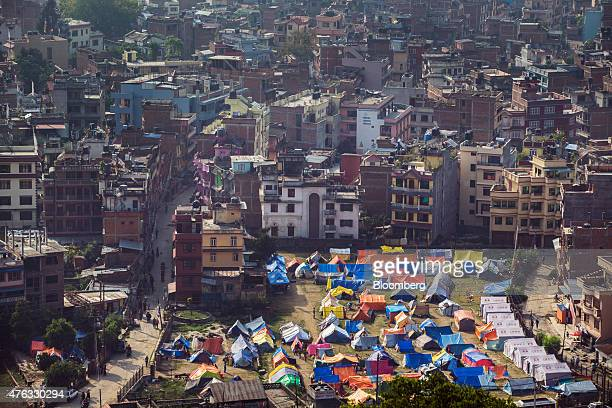 Tents stand at an internal displacement camp in Kathamandu Nepal on Sunday May 31 2015 Nepal's gross domestic product will probably grow 38% in the...