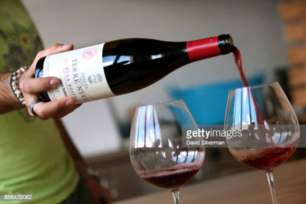 Tenuta delle Terre Nere's Etna Rosso DOC Calderara Sottana 2015 red wine is served during a tasting at the winery located on the northern slope of...