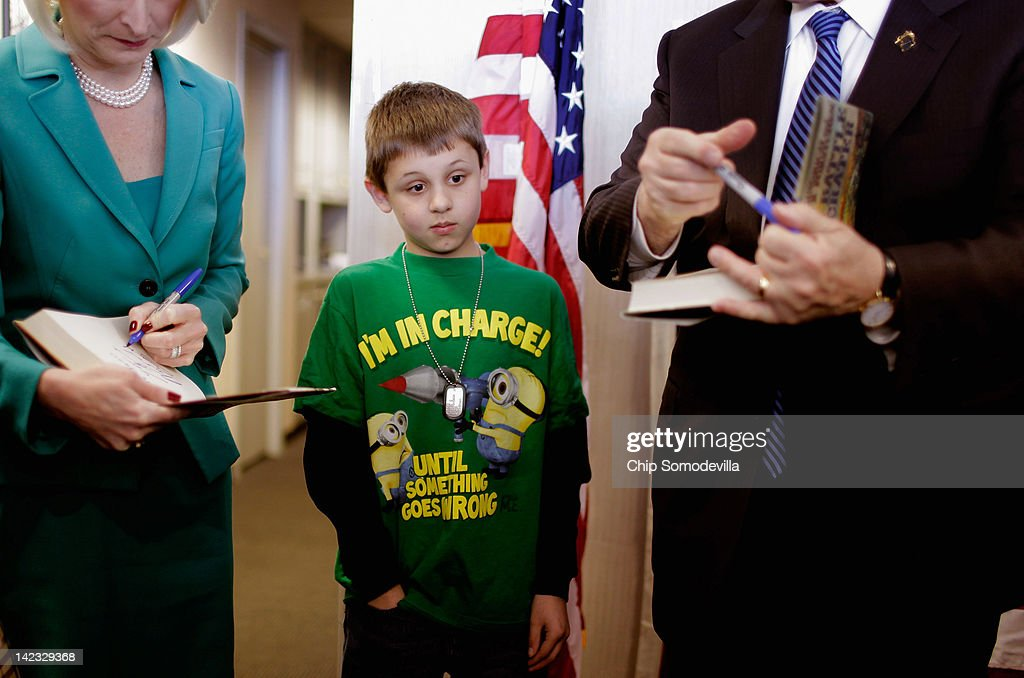 Ten-year-old James McKane of Frederick (C) watches as Republican presidential candidate, former House Speaker <a gi-track='captionPersonalityLinkClicked' href=/galleries/search?phrase=Newt+Gingrich&family=editorial&specificpeople=202915 ng-click='$event.stopPropagation()'>Newt Gingrich</a> (R-GA) (R) and his wife <a gi-track='captionPersonalityLinkClicked' href=/galleries/search?phrase=Callista+Gingrich&family=editorial&specificpeople=4374496 ng-click='$event.stopPropagation()'>Callista Gingrich</a> sign McKane's copies of 'The Battle of the Crater' during a campaign event at The Frederick Motor Company, a Ford auto dealership, April 2, 2012 in Frederick, Maryland. Maryland will hold one of three primaries in the nation Tuesday. After acknowledging it is impossible for him to win the GOP presidential nomination outright, Gingrich has vowed to stay in the presidential race even after firing a third of his campaign staff last week, taking the fight to the party convention.