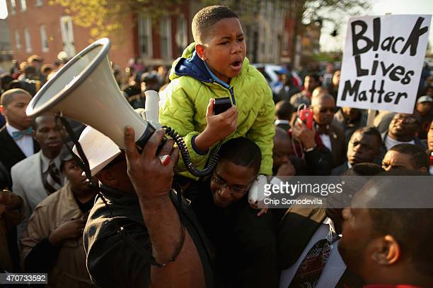 Tenyearold Robert Dunn uses a megaphone to address hundreds of demonstrators during a protest against police brutality and the death of Freddie Gray...