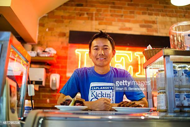 Tenzin Nordhen poses for a photograph at the Caplasnky's restaurant and deli on College Street on September 3 2015 Nordhen a recent immigrant to...