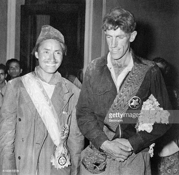Tenzing Norgay and Edmund Hillary pose for a portrait after being honored by King Tribhuvana Norgay was presented with the Nepal Tara and Hillary...