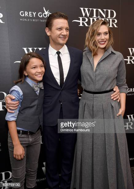 Teo Briones Jeremy Renner and Elizabeth Olsen attend the Screening Of 'Wind River' at The Museum of Modern Art on August 2 2017 in New York City