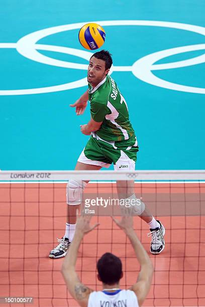 Teodor Salparov of Bulgaria looks for a return against Alexander Volkov of Russia during the Men's Volleyball Semifinals on Day 14 of the London 2012...