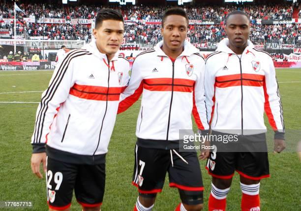 Teofilo Gutierrez Carlos Carbonero and Eder Alvarez Balanta of River Plate pose before a match between River Plate and Colon de Santa Fe as part of...