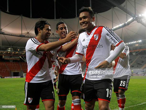 Teofilo Gutierrez celebrates with teammates after scoring the opening goal during a match between Gimnasia y Esgrima La Plata and River Plate as part...