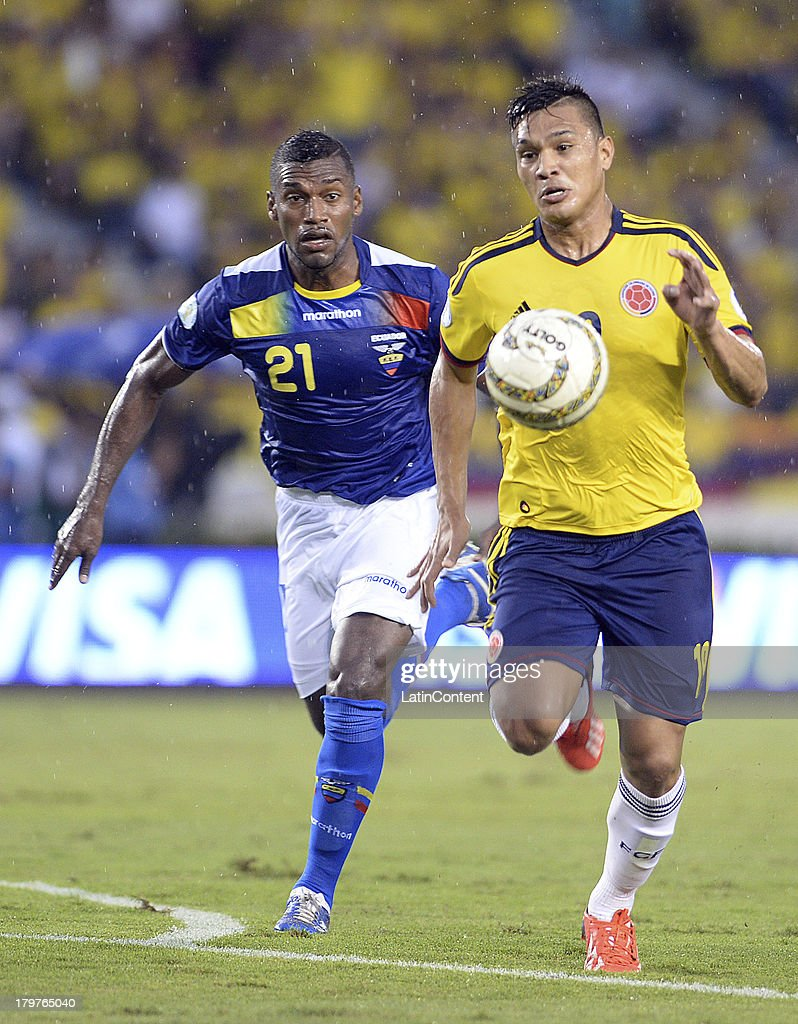 Teofilo Gutierrez of Colombia (R) and Gabriel Achilier of Ecuador (L) fight for the ball during a match between Colombia and Ecuador as part of the 15th round of the South American Qualifiers at Metropolitano Roberto Melendez Stadium on September 06, 2013 in Barranquilla, Colombia.