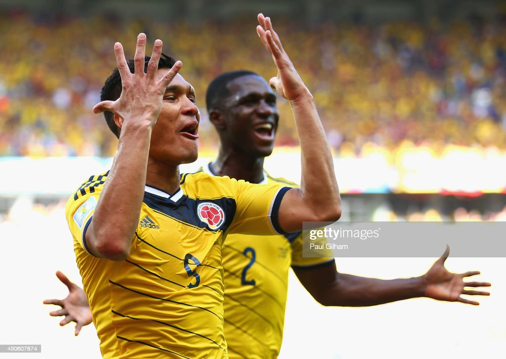 <a gi-track='captionPersonalityLinkClicked' href=/galleries/search?phrase=Teofilo+Gutierrez&family=editorial&specificpeople=5901237 ng-click='$event.stopPropagation()'>Teofilo Gutierrez</a> of Colombia (L) celebrates scoring his team's second goal with <a gi-track='captionPersonalityLinkClicked' href=/galleries/search?phrase=Cristian+Zapata&family=editorial&specificpeople=854055 ng-click='$event.stopPropagation()'>Cristian Zapata</a> during the 2014 FIFA World Cup Brazil Group C match between Colombia and Greece at Estadio Mineirao on June 14, 2014 in Belo Horizonte, Brazil.