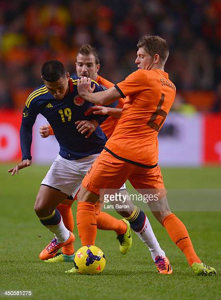 Teofilo Gutierrez of Colombia challenges Stijn Schaars of Netherlands during the International Friendly match between Netherlands and Colombia at...
