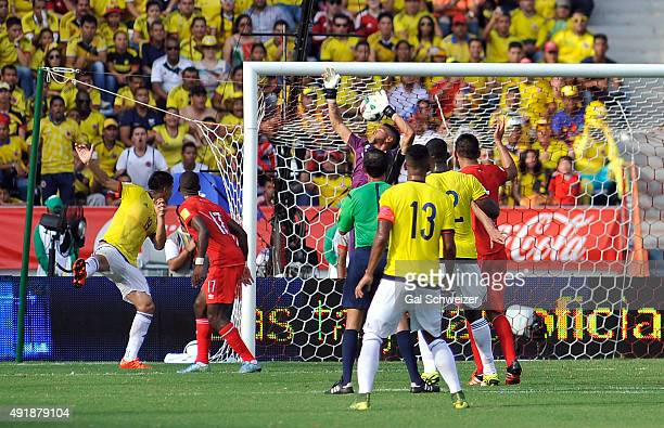 Teofilo Gutierrez of Colombia heads the ball to score the opening goal during a match between Colombia and Peru as part of FIFA 2018 World Cup...