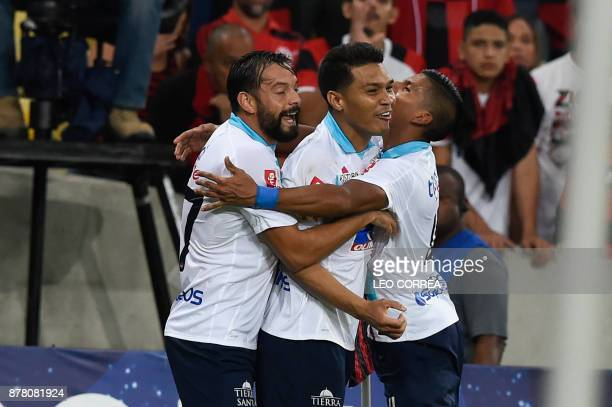 Teofilo Gutierrez of Colombia's Junior de Barranquilla celebrates with teammates after scoring against Brazil's Flamengo during their Copa...