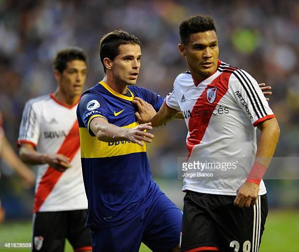 Teofilo Gutierrez of River Plate and Fernando Gago of Boca Juniors during a match between Boca Juniors and River Plate as part of 10th round of...